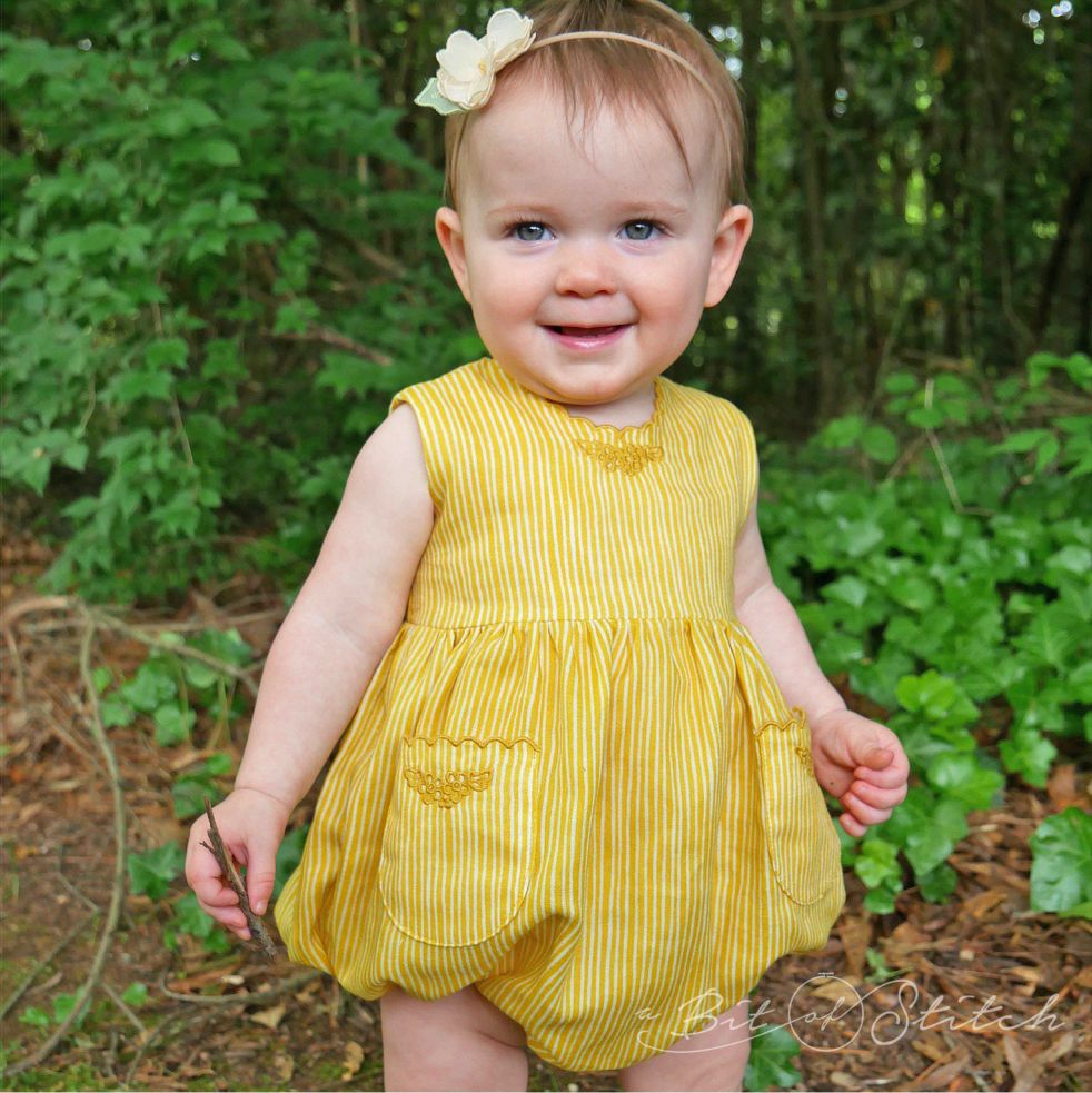 Finally, a smile from Miss Marlow! Romper made with designs from Pretty Petticoats and Petite Scalloped Pocket! link: /shop/petite-scalloped-pocket-2/