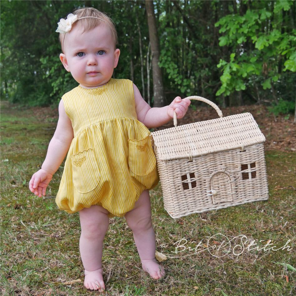 Marlow looking serious but adorable in a romper made with designs from Pretty Petticoats and Petite Scalloped Pocket! link: /shop/pretty-petticoats/